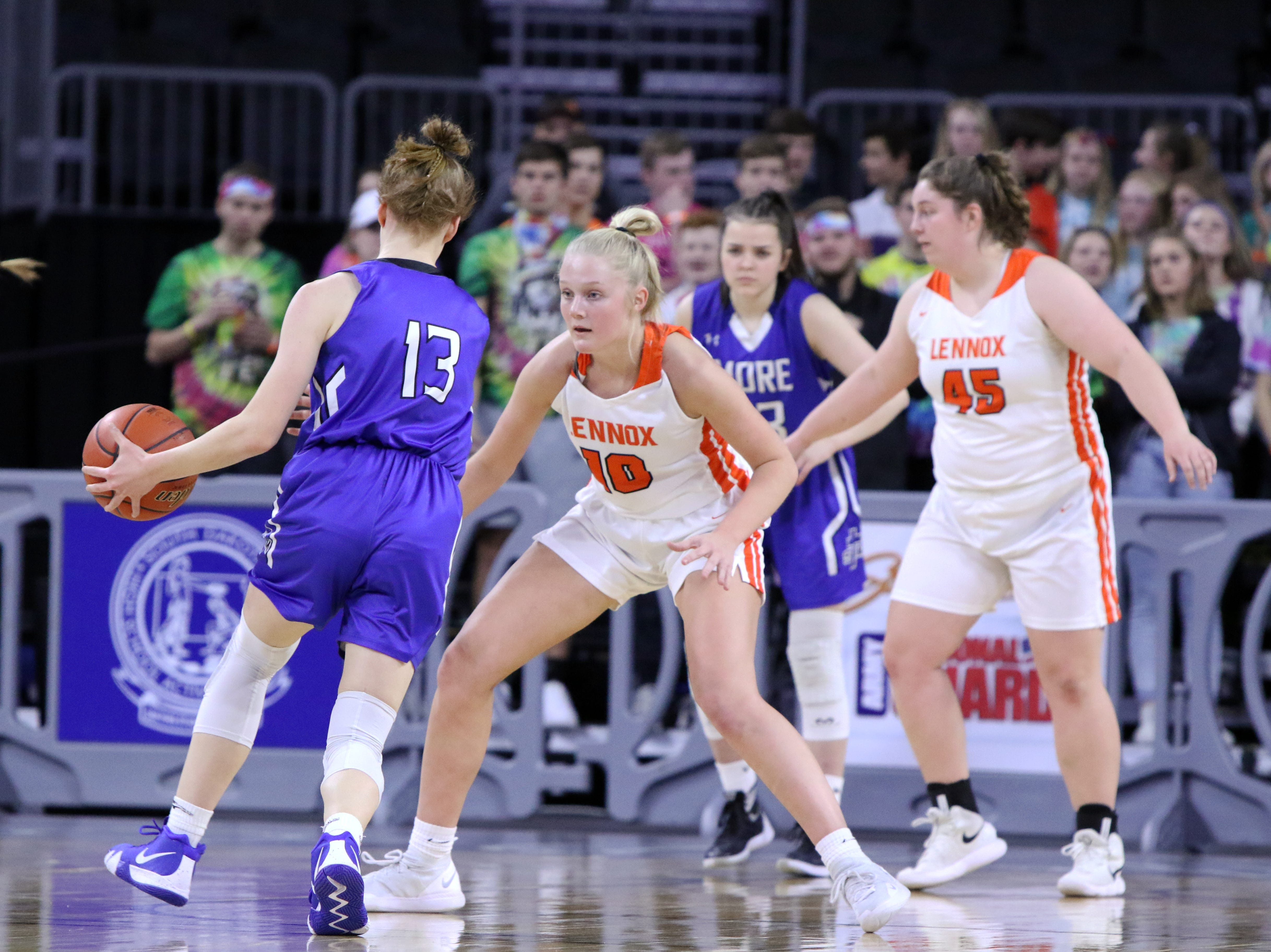 Madysen Vlastuin of Lennox pressures Haliegh Timmer of St Thomas More defends Thursday night's game at the Premier Center in Sioux Falls.
