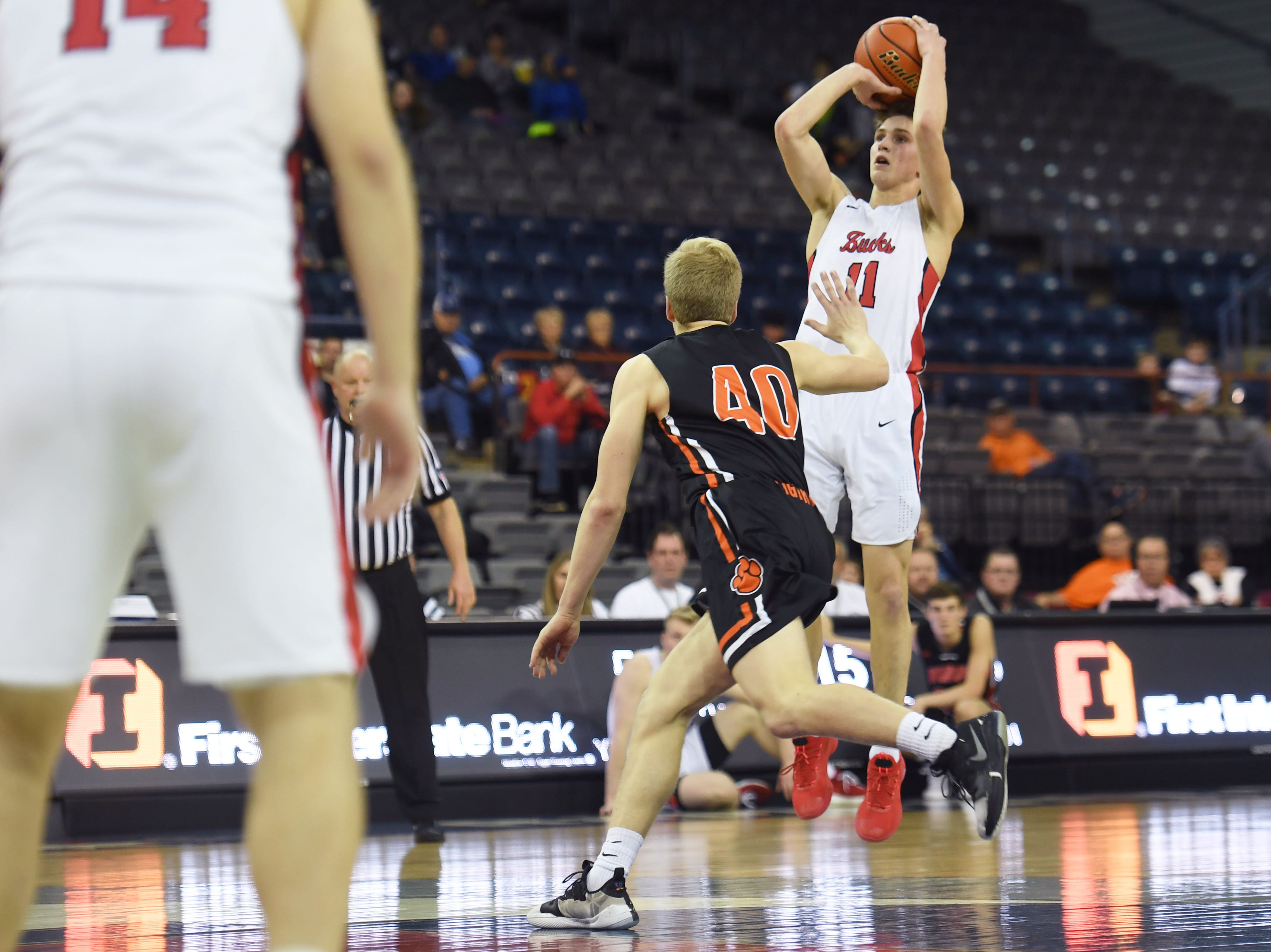 Yankton's Cooper Cornemann takes a shot against Huron in the Class AA quarterfinals Thursday, March 14, in Rapid City.