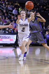 West Central's Rylee Haldeman passes the ball ahead of Reagan Klooz of MVP during Thursday's game at the Premier Center in Sioux Falls.