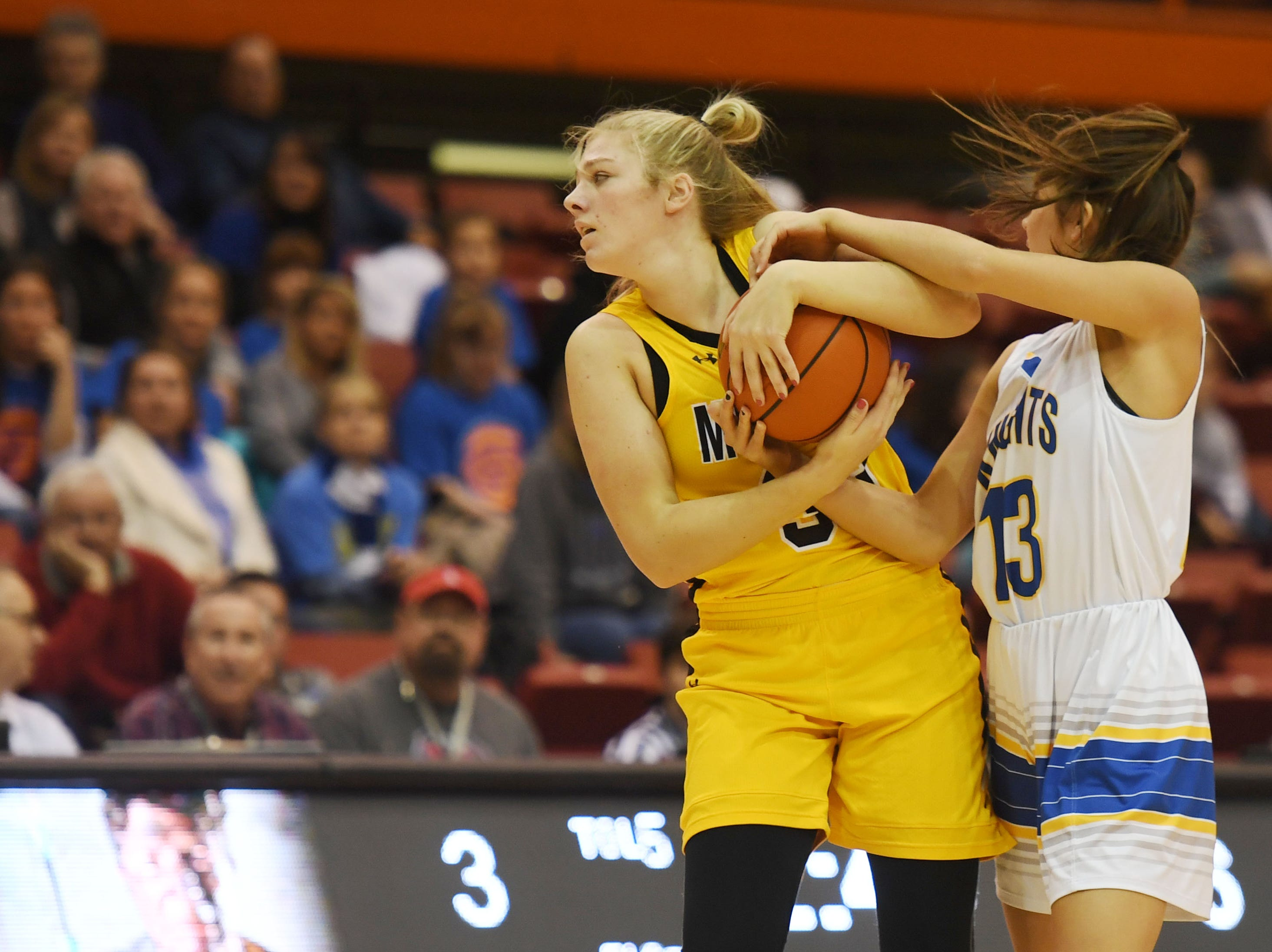 Mitchell's Macy Kempf goes against O'Gorman's Isabelle Moore during the Class AA quarterfinals Thursday, March 14, in Rapid City.