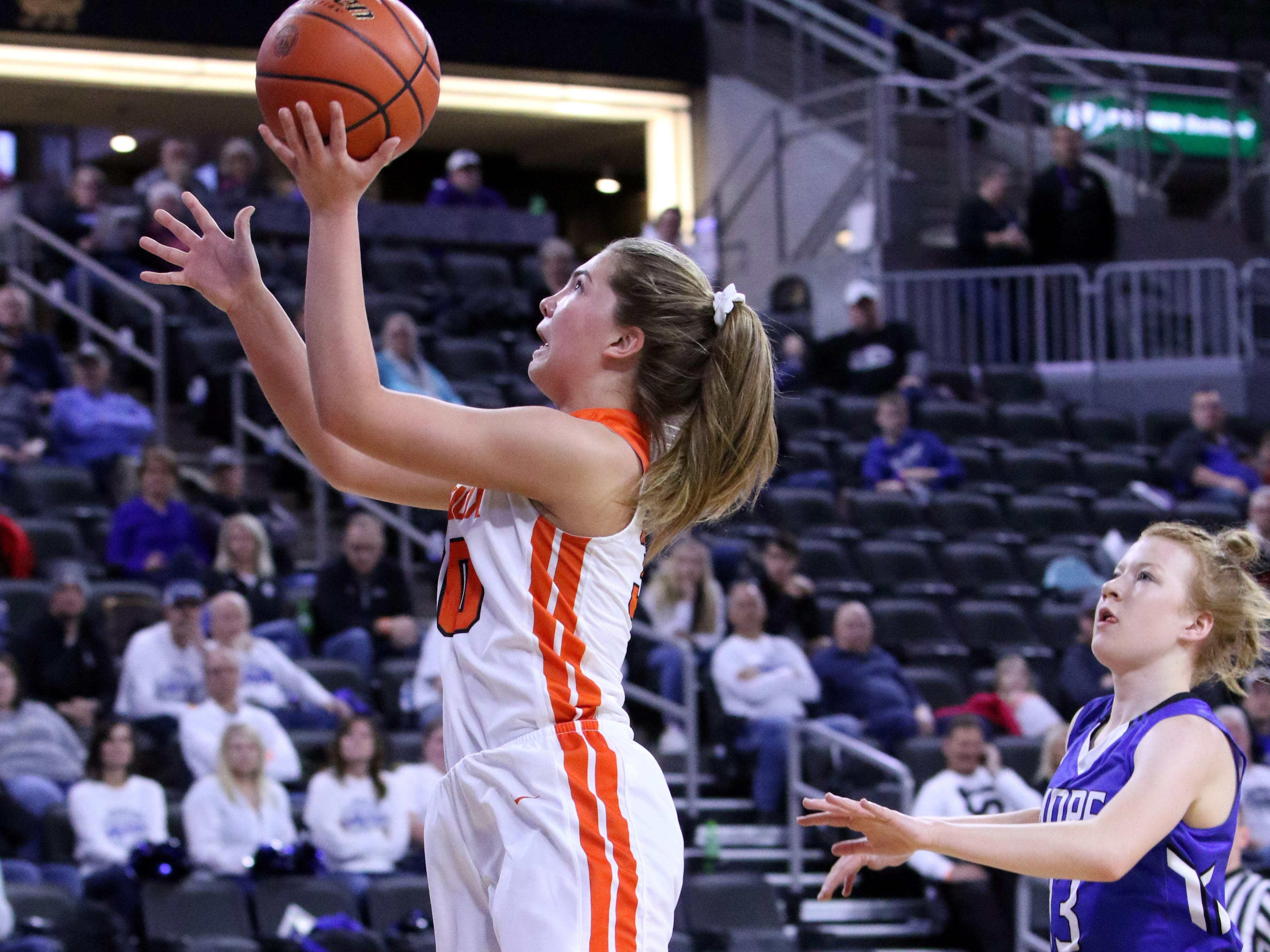 Rianna Fillipi of Lennox goes in for a layup ahead of Haleigh Timmer of St Thomas More during Thursday's game at the Premier Center in Sioux Falls.
