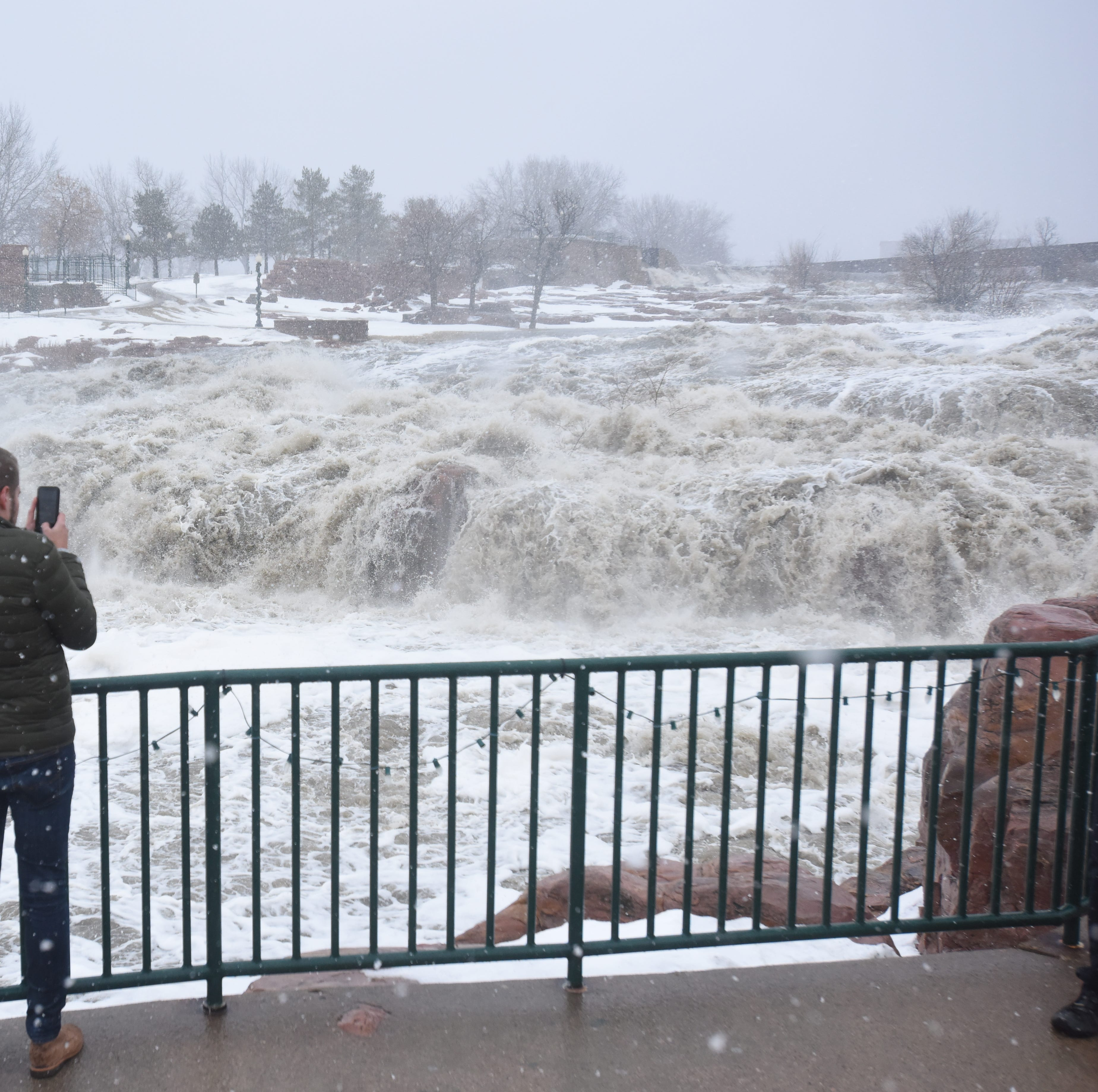 How many people have been ticketed for entering flooded parks?