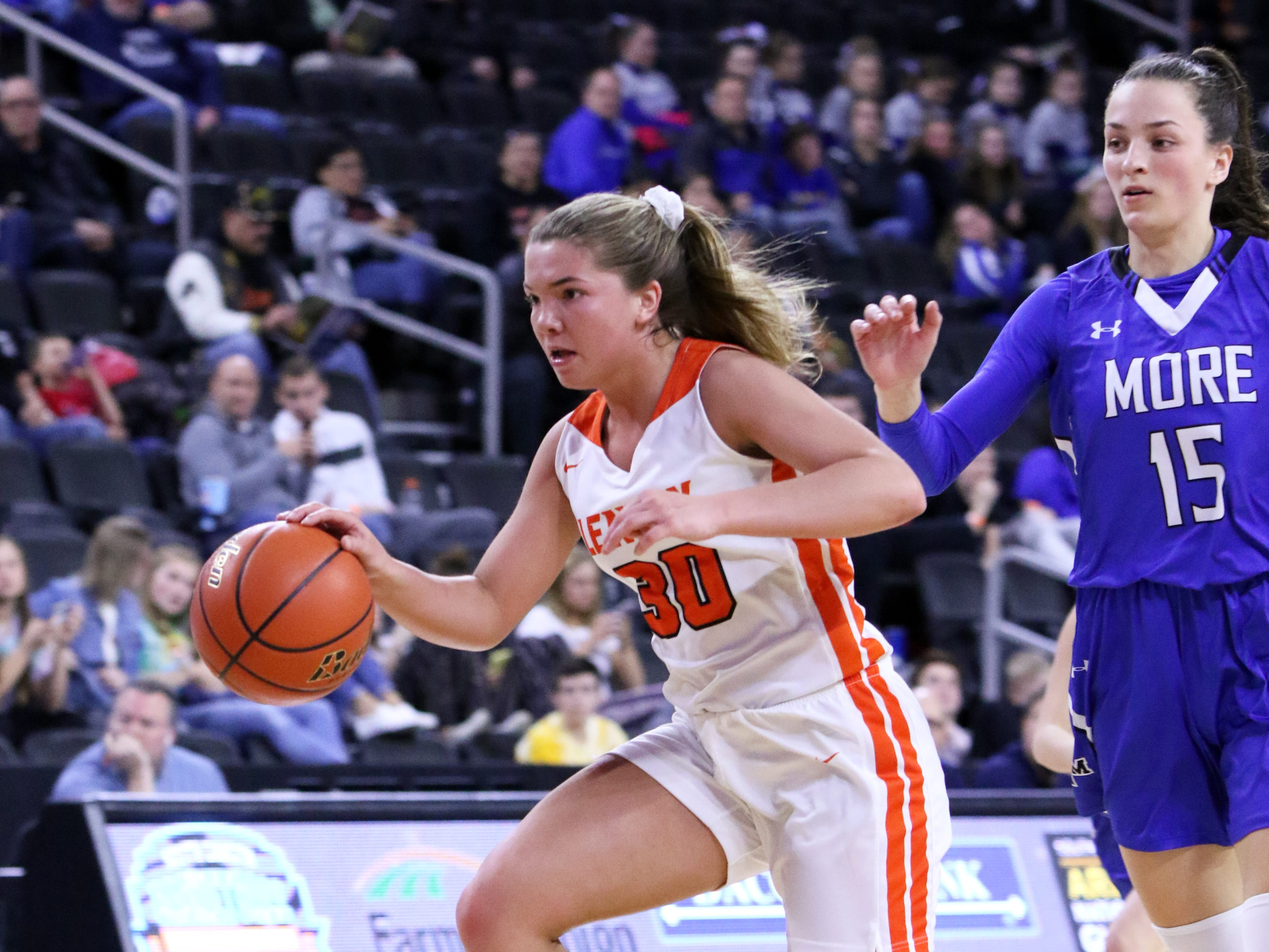 Rianna Fillipi of Lennox sprints away from Ciara Benson of St Thomas More during Thursday's game at the Premier Center in Sioux Falls.