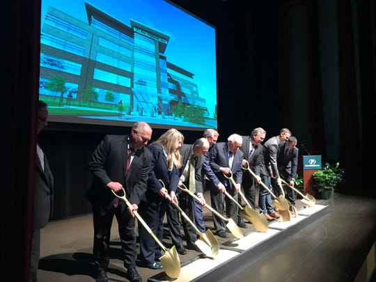 First Premier Bank leadership, joined by owner T. Denny Sanford, hosted a ceremonial ground breaking event Thursday for the bank's new headquarters. Construction is expected to begin next week.