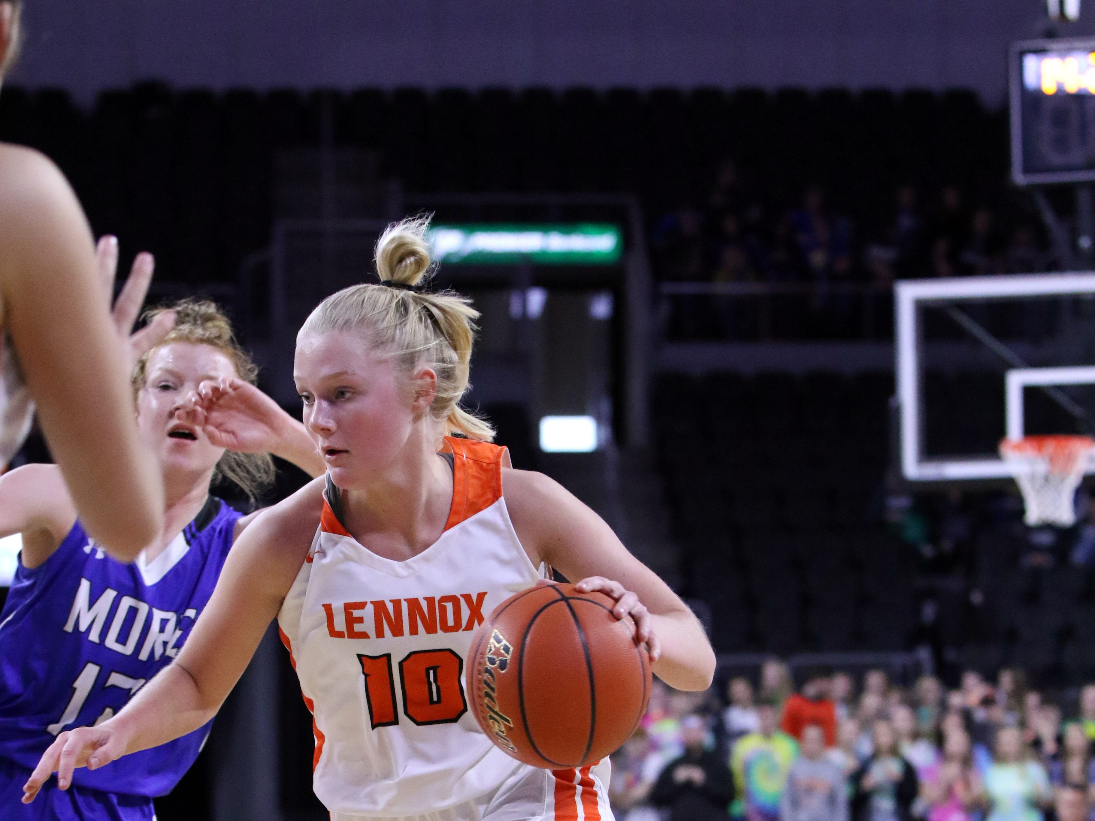 Msdysen Vlastuin of Lennox dribbles past the defense by Haleigh Timmer of St Thomas More during Thursday's game at the Premier Center.