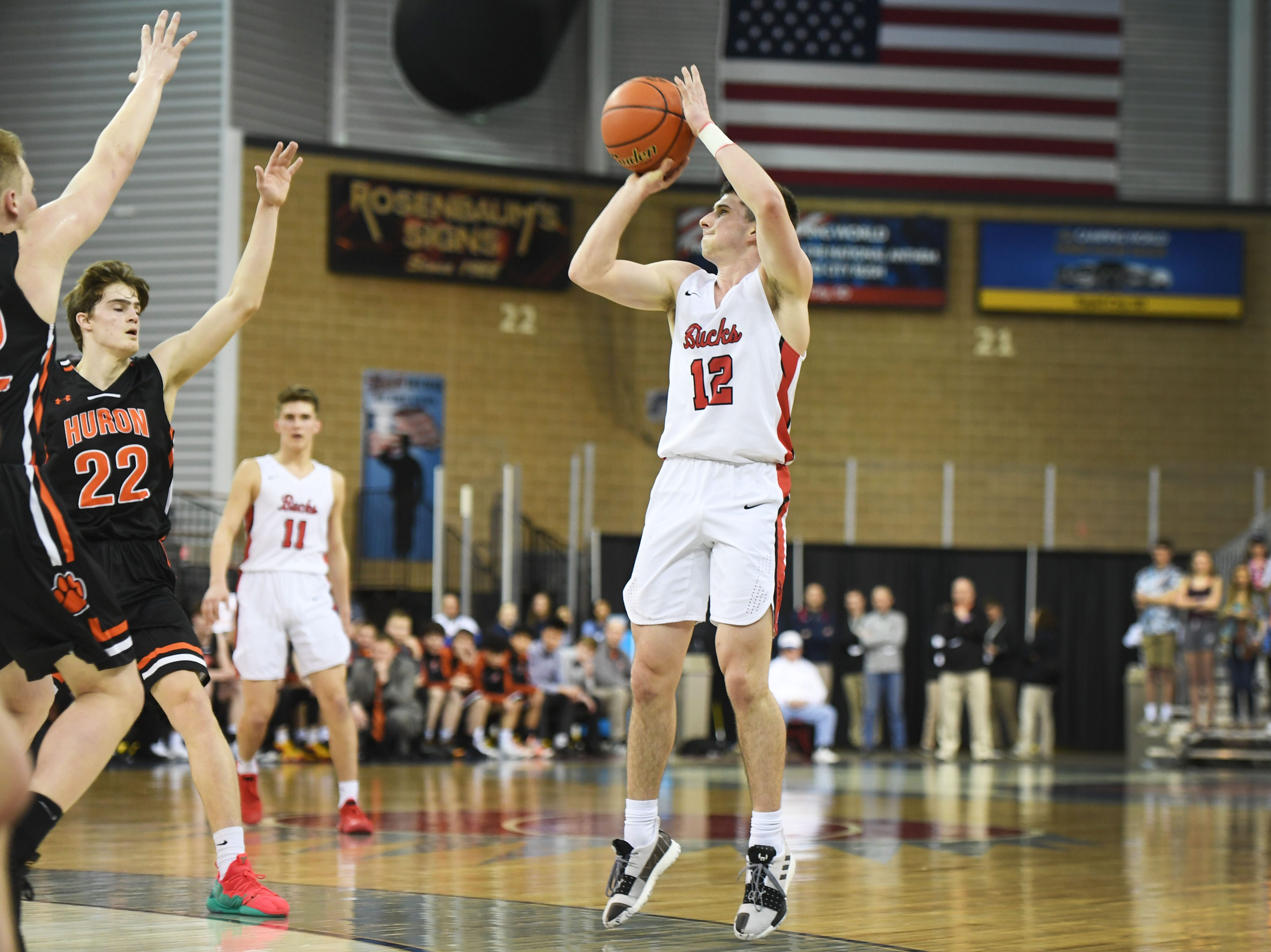 Yankton's Owen Feser takes a shot against Huron in the Class AA quarterfinals Thursday, March 14, in Rapid City.