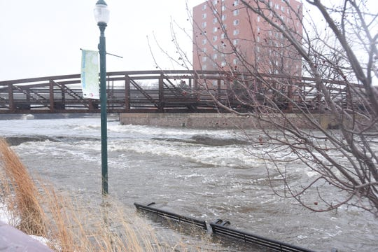 The Big Sioux River rose to a dangerous level Thursday, March 14, after heavy rainfall flooded portions of Sioux Falls.  The bike trail by Cherapa Place was completely covered.