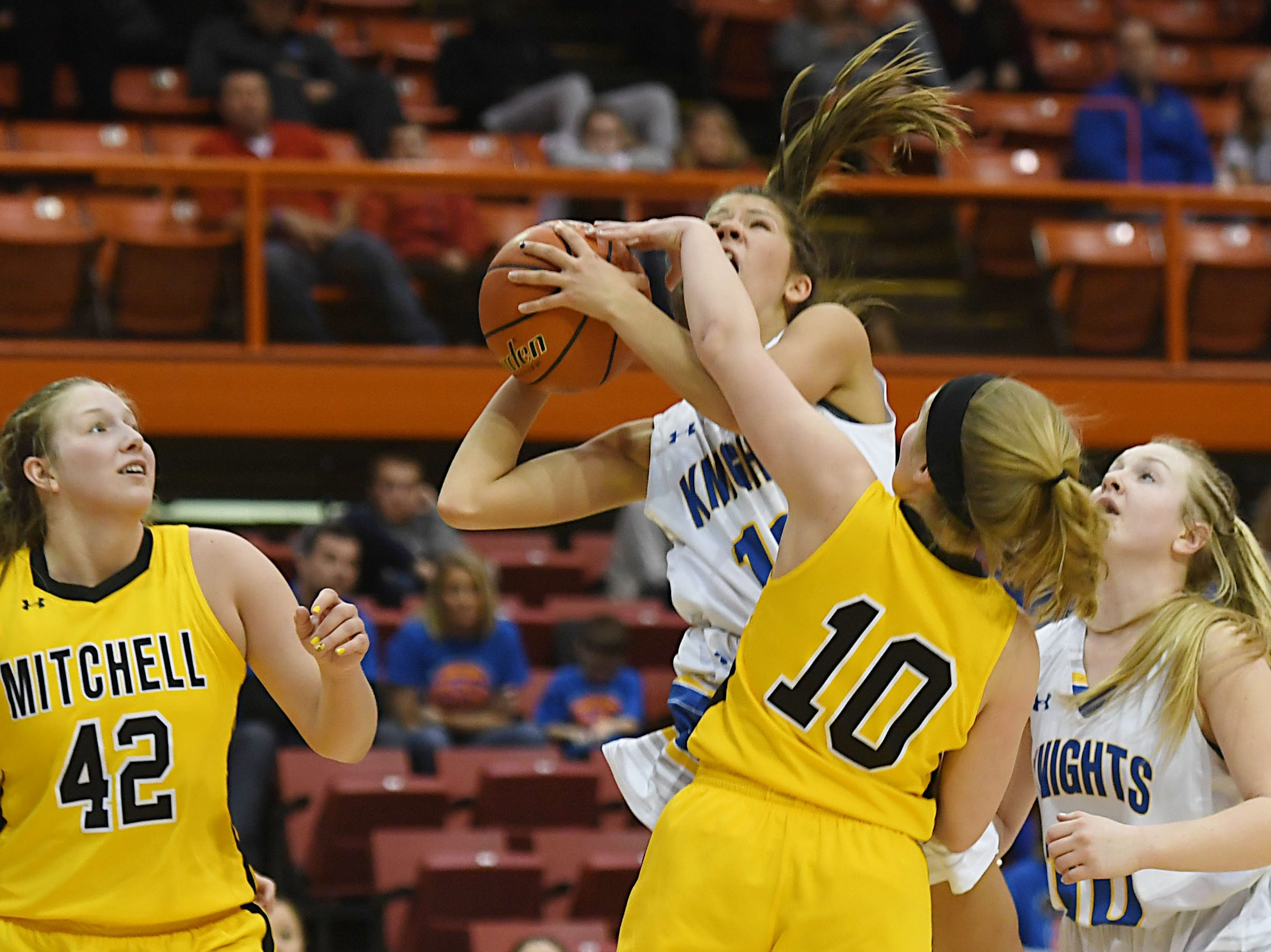 O'Gorman's Isabelle Moore goes against Mitchell defense in the Class AA quarterfinals Thursday, March 14, in Rapid City.