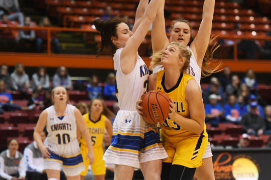 Mitchell's Macy Kempf goes against O'Gorman defense in the Class AA quarterfinals Thursday, March 14, in Rapid City.