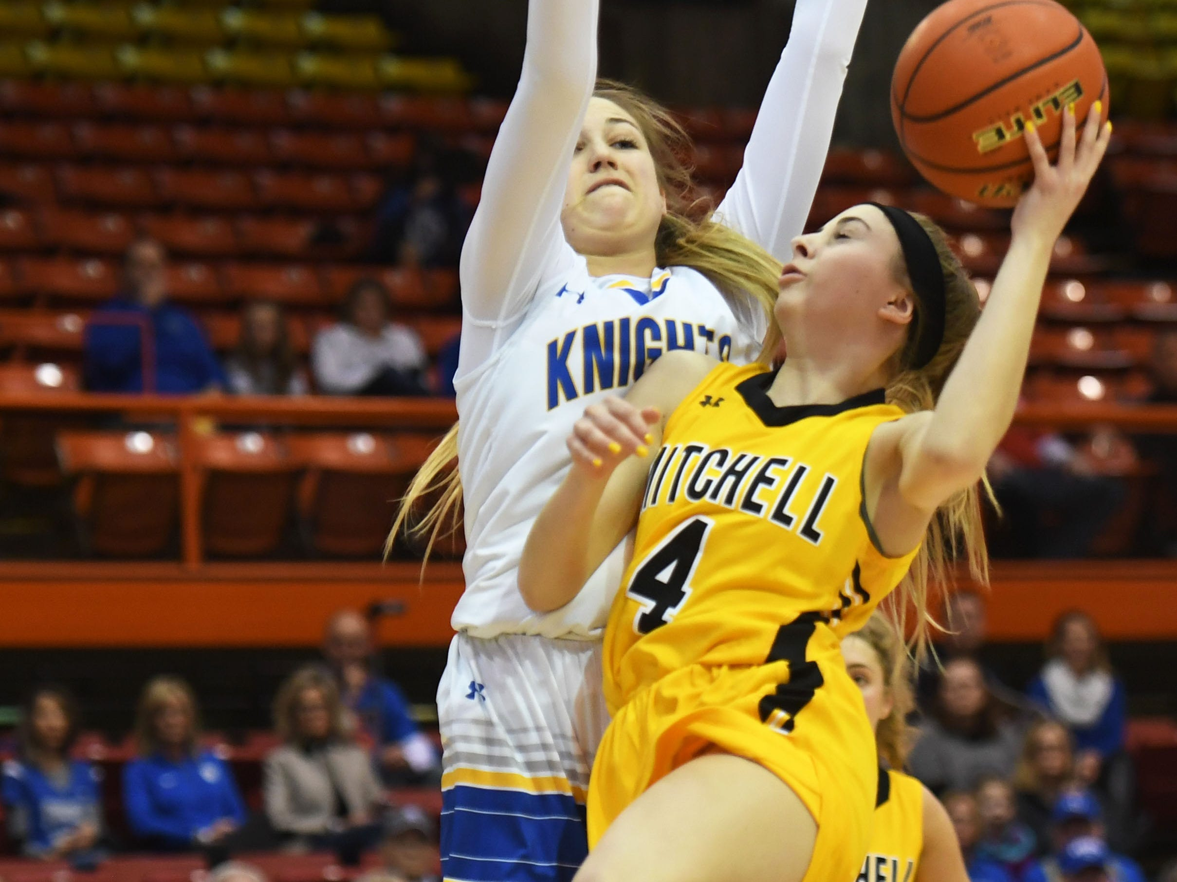 Mitchell's Tess Limberg goes against O'Gorman defense during the Class AA quarterfinals Thursday, March 14, in Rapid City.
