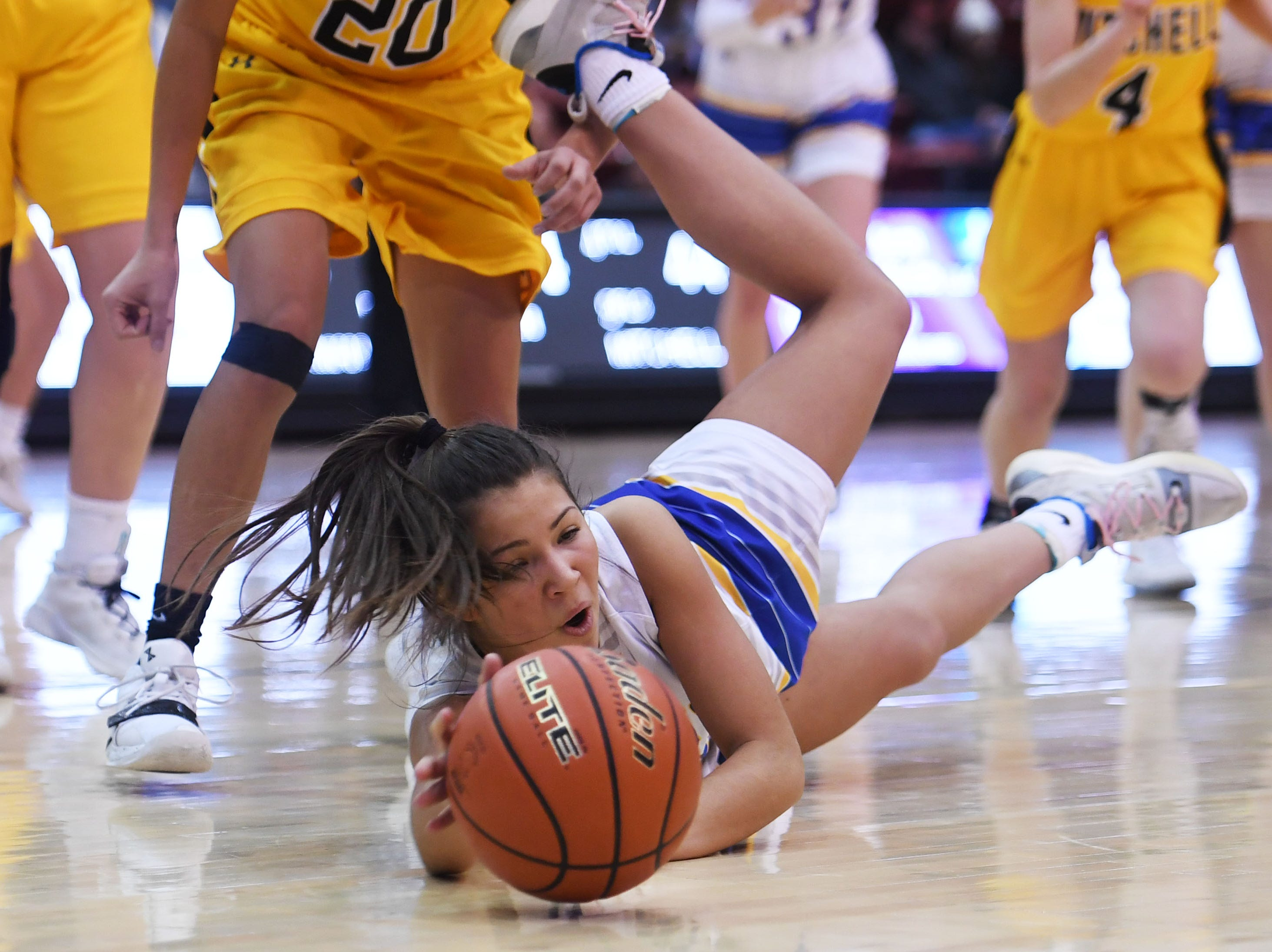 O'Gorman's Isabelle Moore attempts to gain control of the ball during the game against Mitchell in the Class AA quarterfinals Thursday, March 14, in Rapid City.