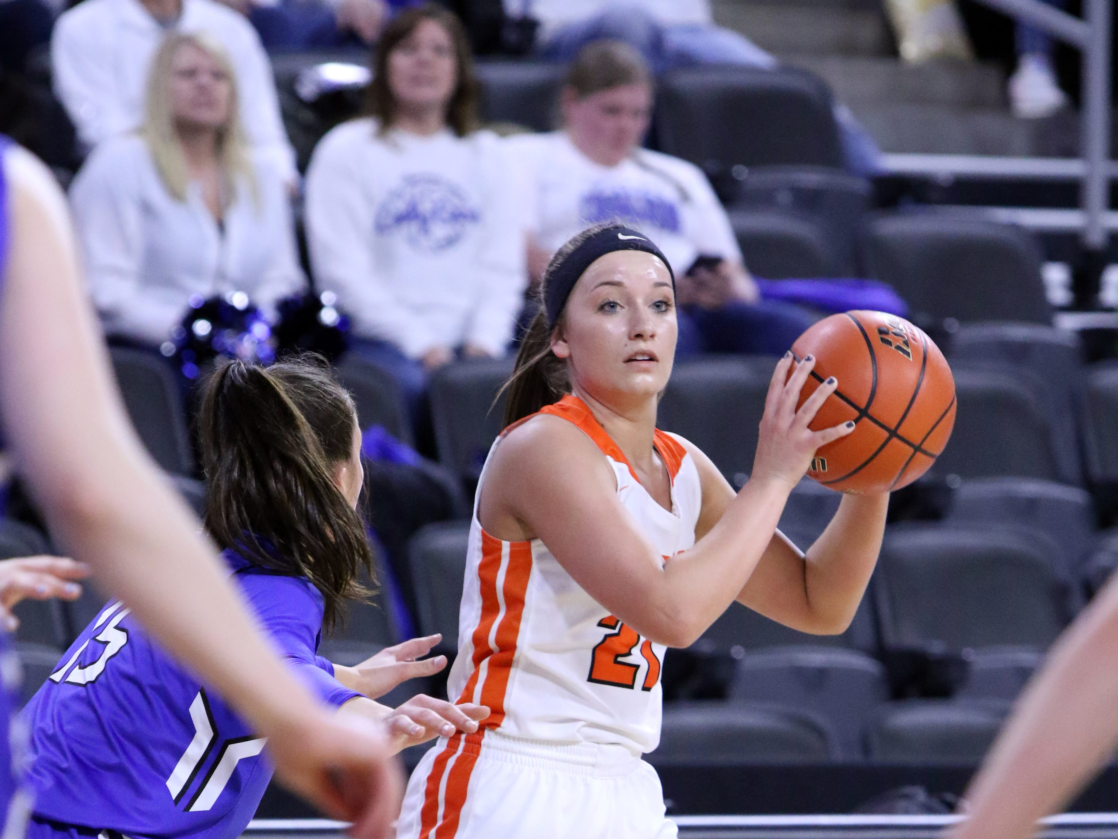 Riley Peters of Lennox gets pressure from Ciara Benson of St Thomas More during Thursday's game at the Premier Center in Sioux Falls.