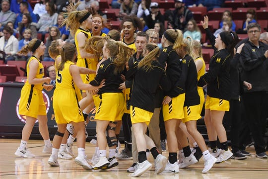 Mitchell celebrates their win against O'Gorman in the Class AA quarterfinals Thursday, March 14, in Rapid City.