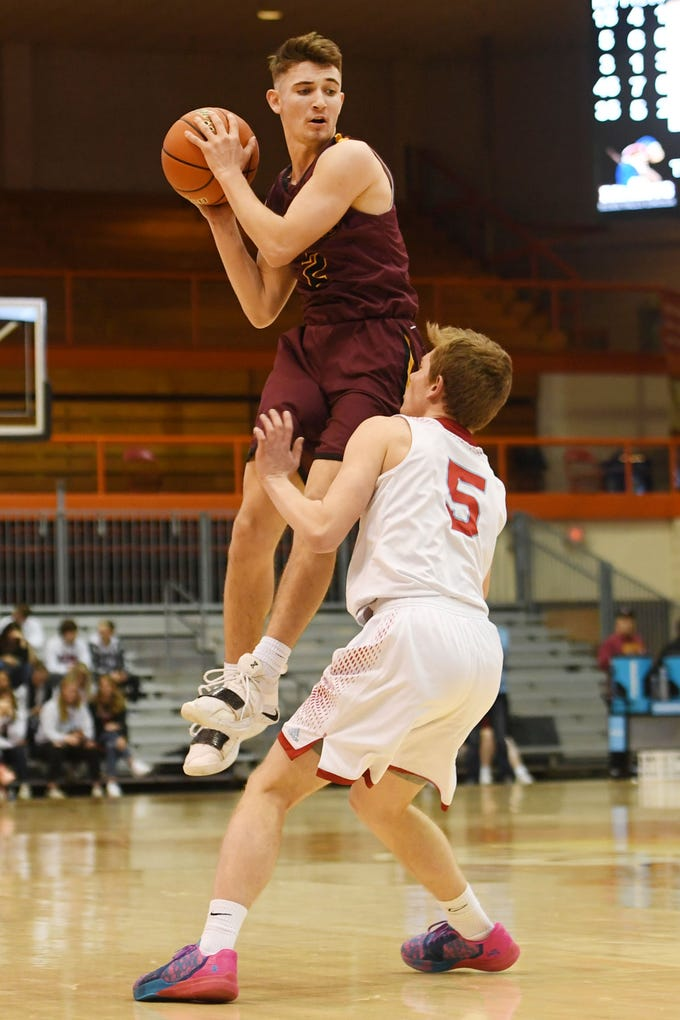 Harrisburg's Nick Hoyt goes against Lincoln's Grant Russell in the Class AA quarterfinals Thursday, March 14, in Rapid City.
