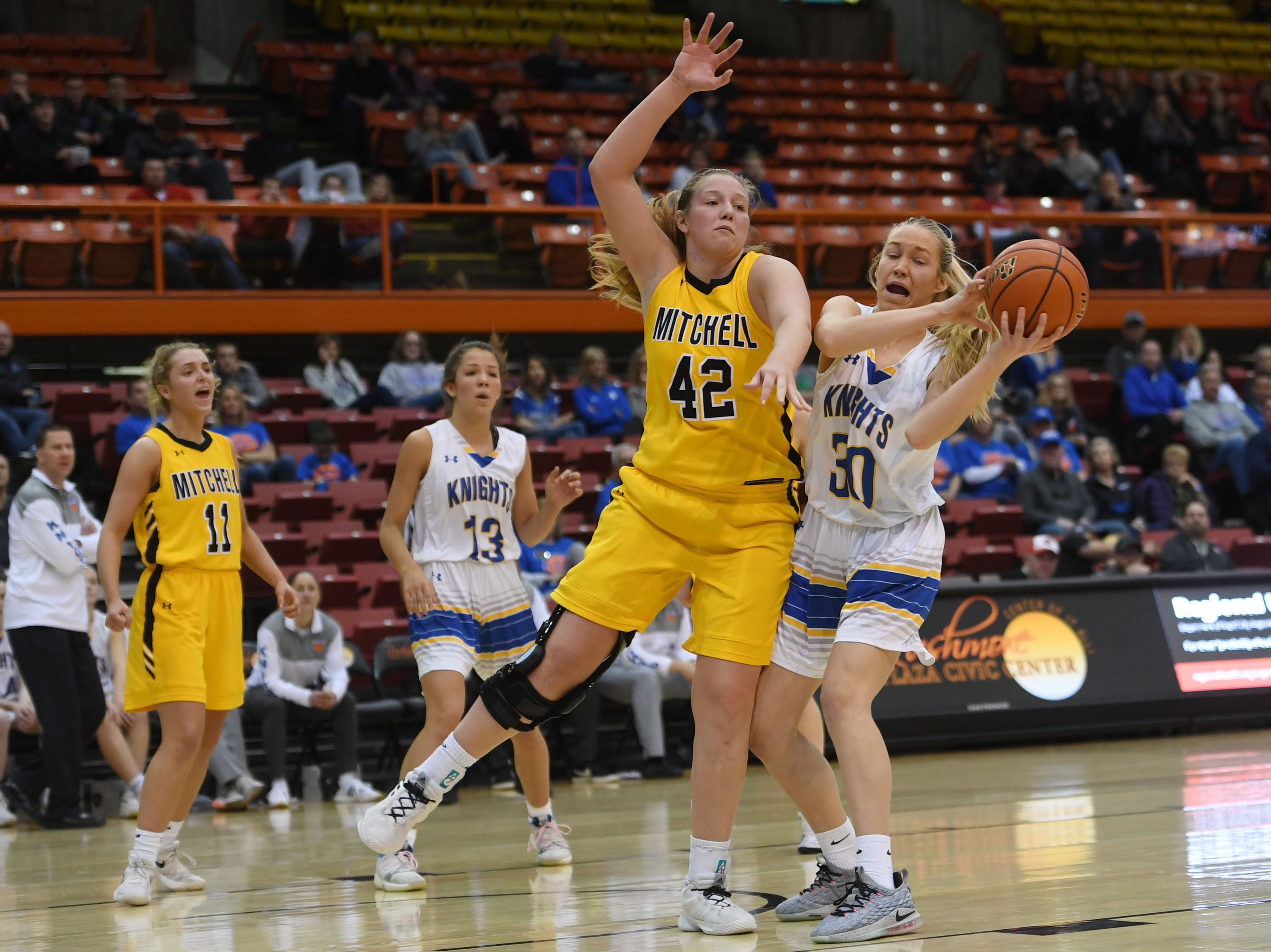 O'Gorman's Hannah Ronsiek goes against Mitchell's 	Mackenzie Miller in the Class AA quarterfinals Thursday, March 14, in Rapid City.