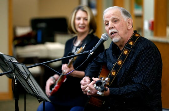 Jan and Bob Alder play music and sing for residents of The Manor at Elfindale on Wednesday, March 14, 2019.