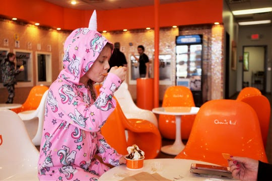 Malia Bragg, 10, enjoys frozen yogurt March 14, 2019 at Orange Leaf at 1349 E. Republic Rd.