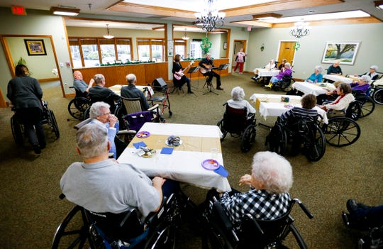 Residents of The Manor at Elfindale listen to music played by Bob and Jan Alder on Wednesday, March 14, 2019.