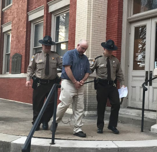 Darin Davis is led away from the Augusta County Courthouse on Wednesday after being convicted of voluntary manslaughter.