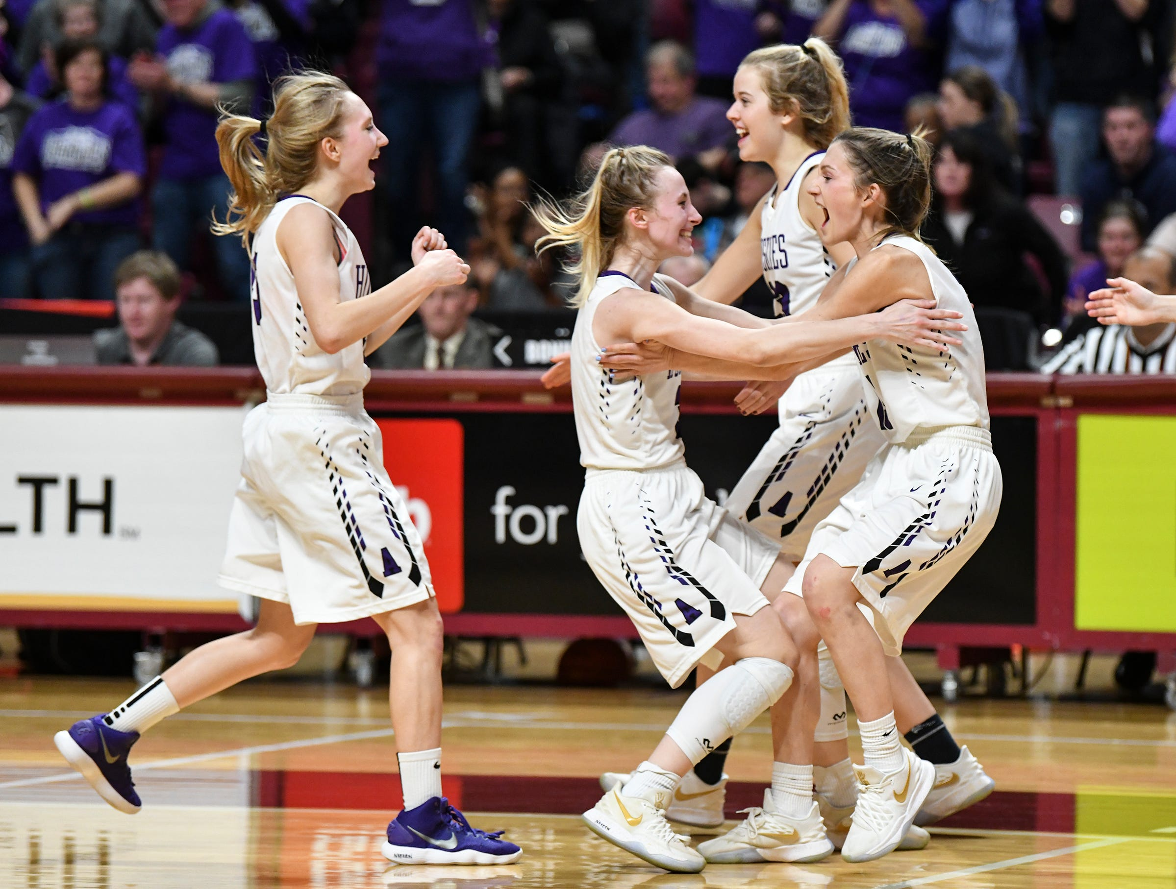 Albany players celebrate their 60-49 win during the state Class 2A quarterfinals game Wednesday, March 13, at the University of Minnesota in Minneapolis.