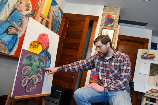 """Adam Spaeth talks about a painting of an """"Octophant"""" during an interview Wednesday, March 13,  in his St. Cloud studio."""