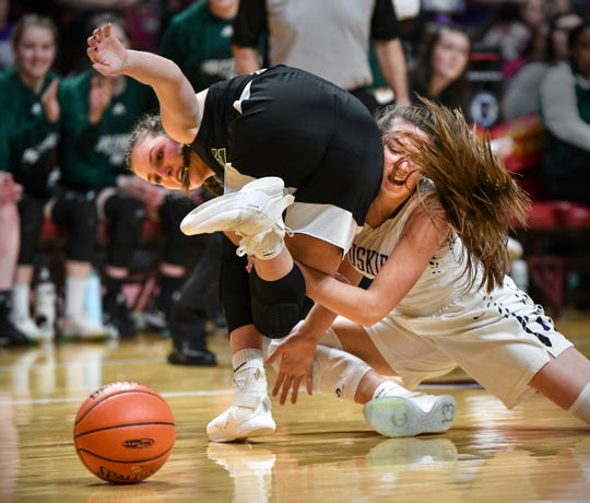 Laigh Steiner of Holy Family and Hannah Lichty of Albany battle for control of a loose ball during the state Class 2A quarterfinals game Wednesday, March 13, at the University of Minnesota in Minneapolis.