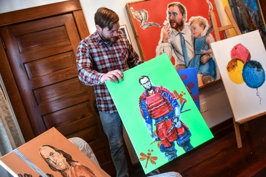 Local artist Adam Spaeth talks about some recent work during an interview Wednesday, March 13,  in his St. Cloud studio.