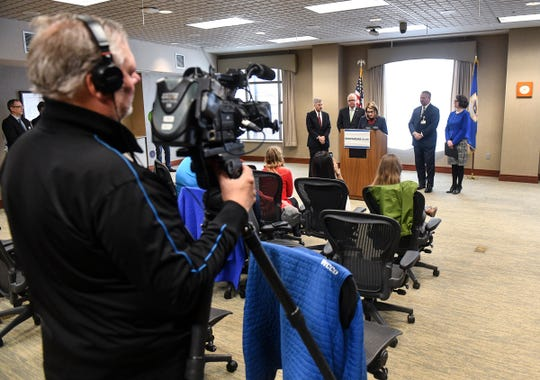 People gather for a press conference held by Gov. Tim Walz and Lieutenant Gov. Peggy Flanagan on the Health Care Access Fund and a provider tax Thursday, March 14,  in St. Cloud.