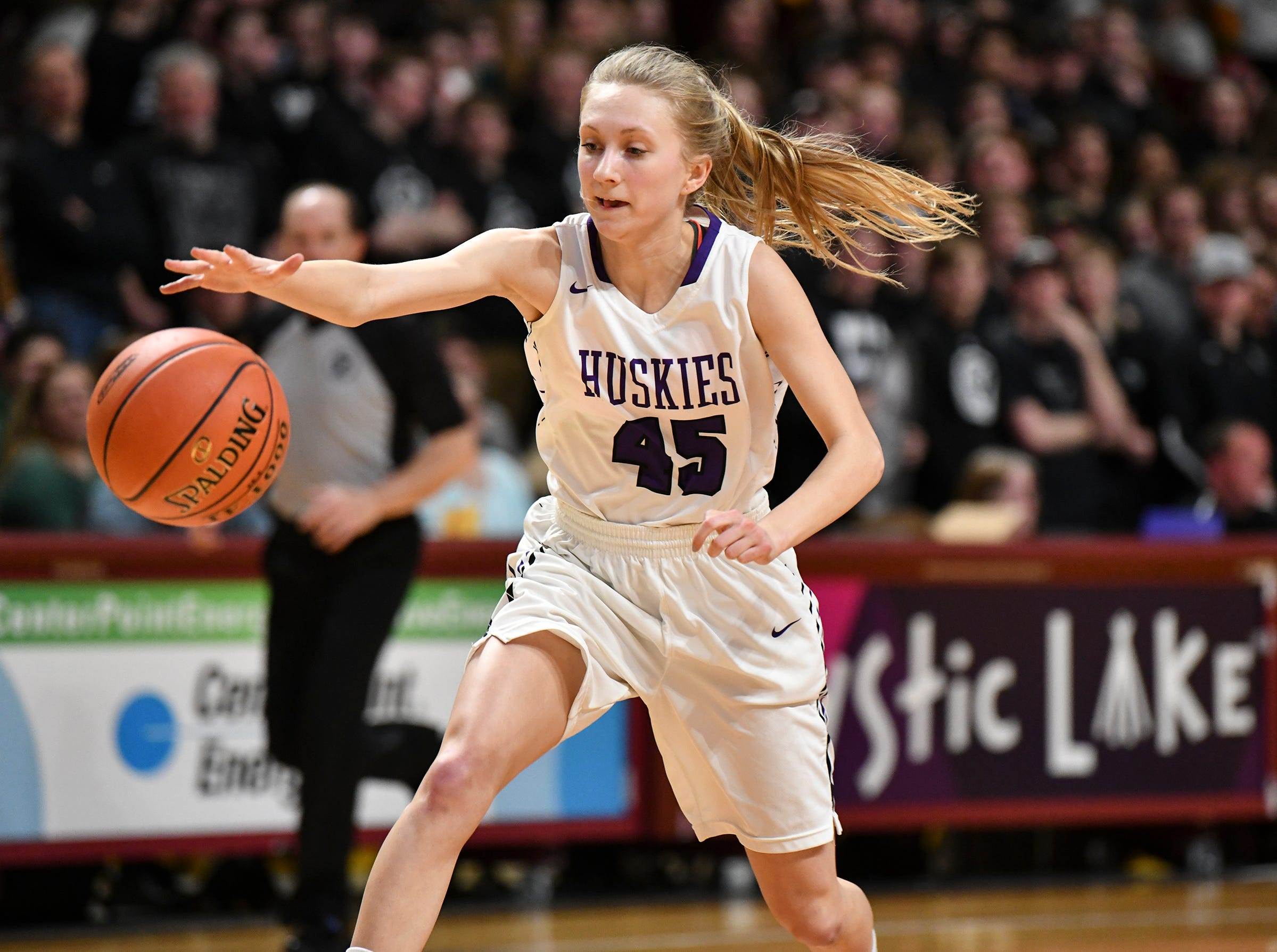 Albany's Rachael Neu gets control of the ball during the state Class 2A quarterfinals game Wednesday, March 13, at the University of Minnesota in Minneapolis.