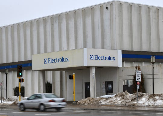 Traffic moves past the Electrolux employee entrance on 33rd Avenue North Thursday, March 14, in St. Cloud.