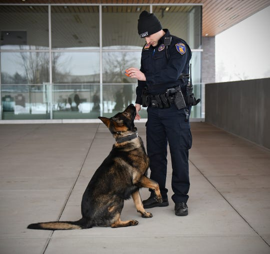 St. Cloud police officer Nick Carlson works with K-9 Riggs Wednesday, March 13, at the St. Cloud Police Department.