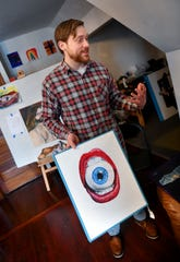 Adam Spaeth holds one of his works during an interview Wednesday, March 13,  2019, in his St. Cloud studio.