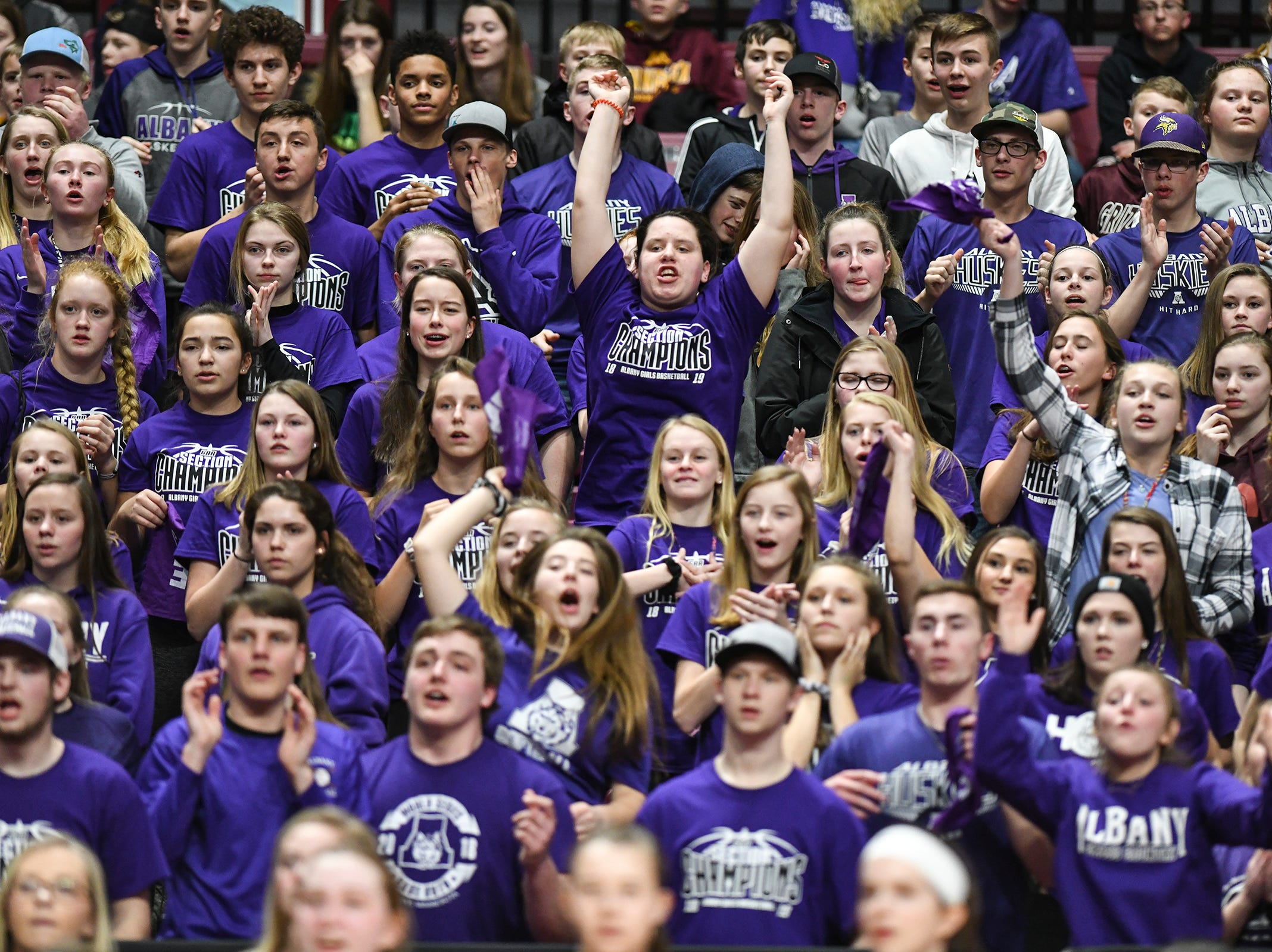 Albany fans cheer for their team during the state Class 2A quarterfinals game Wednesday, March 13, at the University of Minnesota in Minneapolis.