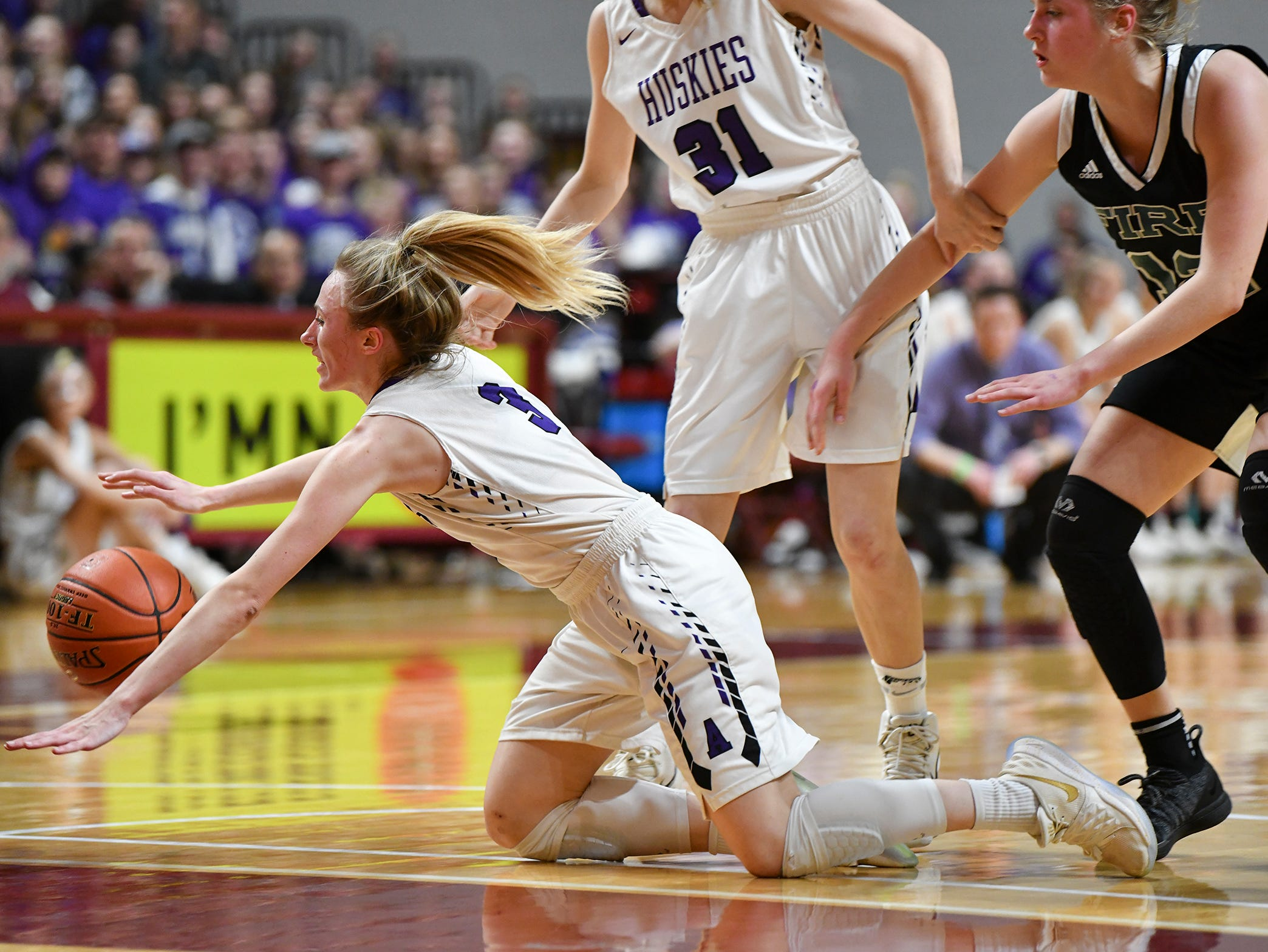 Hannah Litchy dives for a loose ball during the state Class 2A quarterfinals game Wednesday, March 13, at the University of Minnesota in Minneapolis.