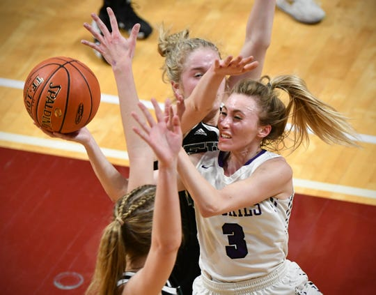Albany's Amanda Kollodge drives to the basket during the state Class 2A quarterfinals game Wednesday, March 13, at the University of Minnesota in Minneapolis.