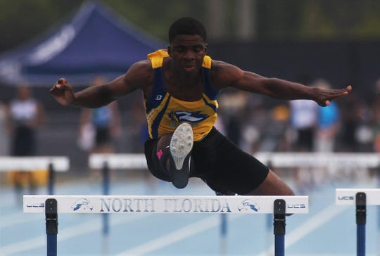 Rickards' Jabari Bryant clears a hurdle during last year's state meet. Bryant took second in the 300m high hurdles. This year, he's tops in his class and a top sprinter as well.