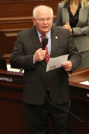 Senator Bill Montford recognizes Angela Drzewiecki, widow of Air Force Staff Sgt. Carl Enis who died in a helicopter crash in Western Iraq, at the opening of the Florida Senate session Thursday, March 14, 2019.