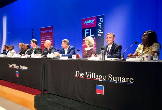 """Leon County and Tallahassee city commissioners take part in the Village Square's annual """"Our Town"""" event Wednesday night at WFSU's public broadcasting center on Red Barber Plaza."""