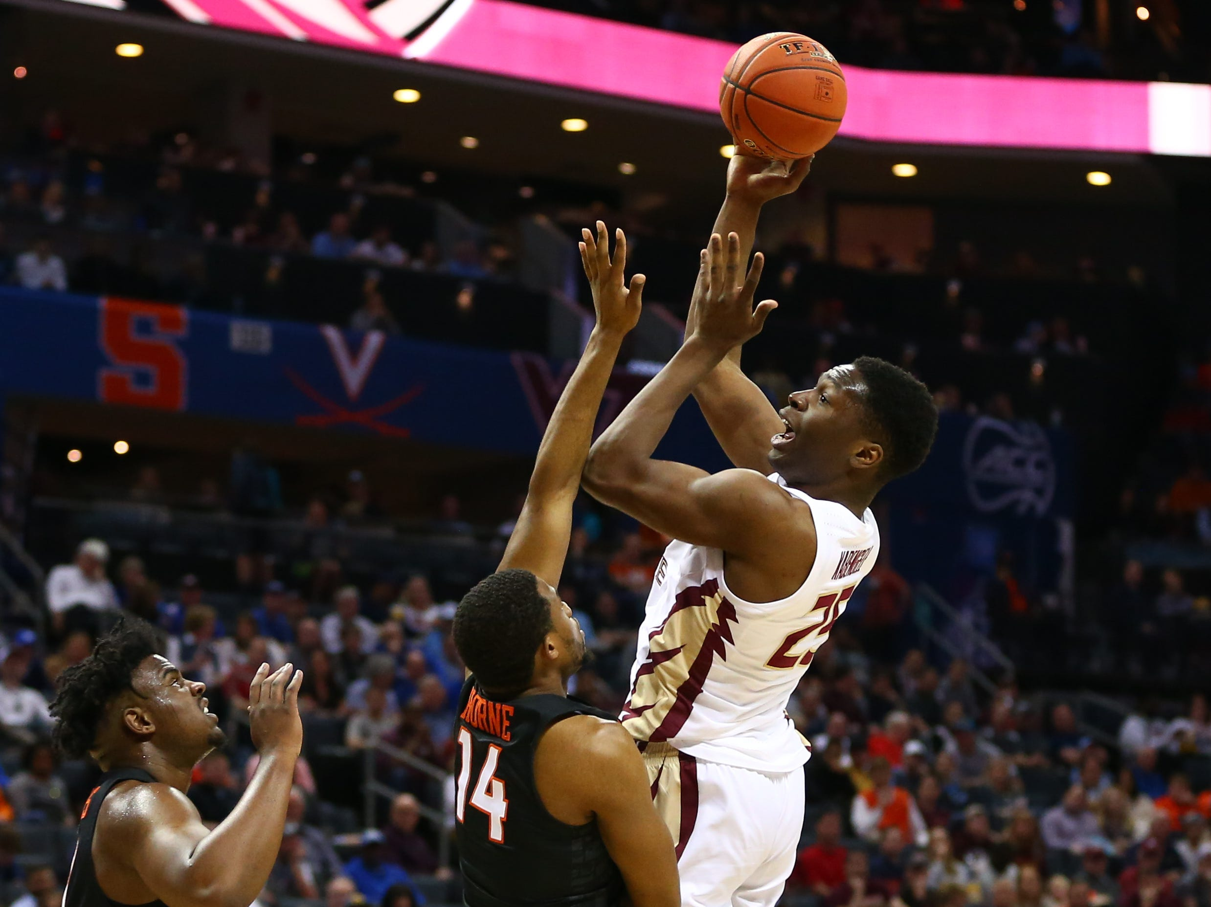 Mar 14, 2019; Charlotte, NC, USA; Florida State Seminoles forward Mfiondu Kabengele (25) shoots the ball against Virginia Tech Hokies forward P.J. Horne (14) in the first half in the ACC conference tournament at Spectrum Center. Mandatory Credit: Jeremy Brevard-USA TODAY Sports