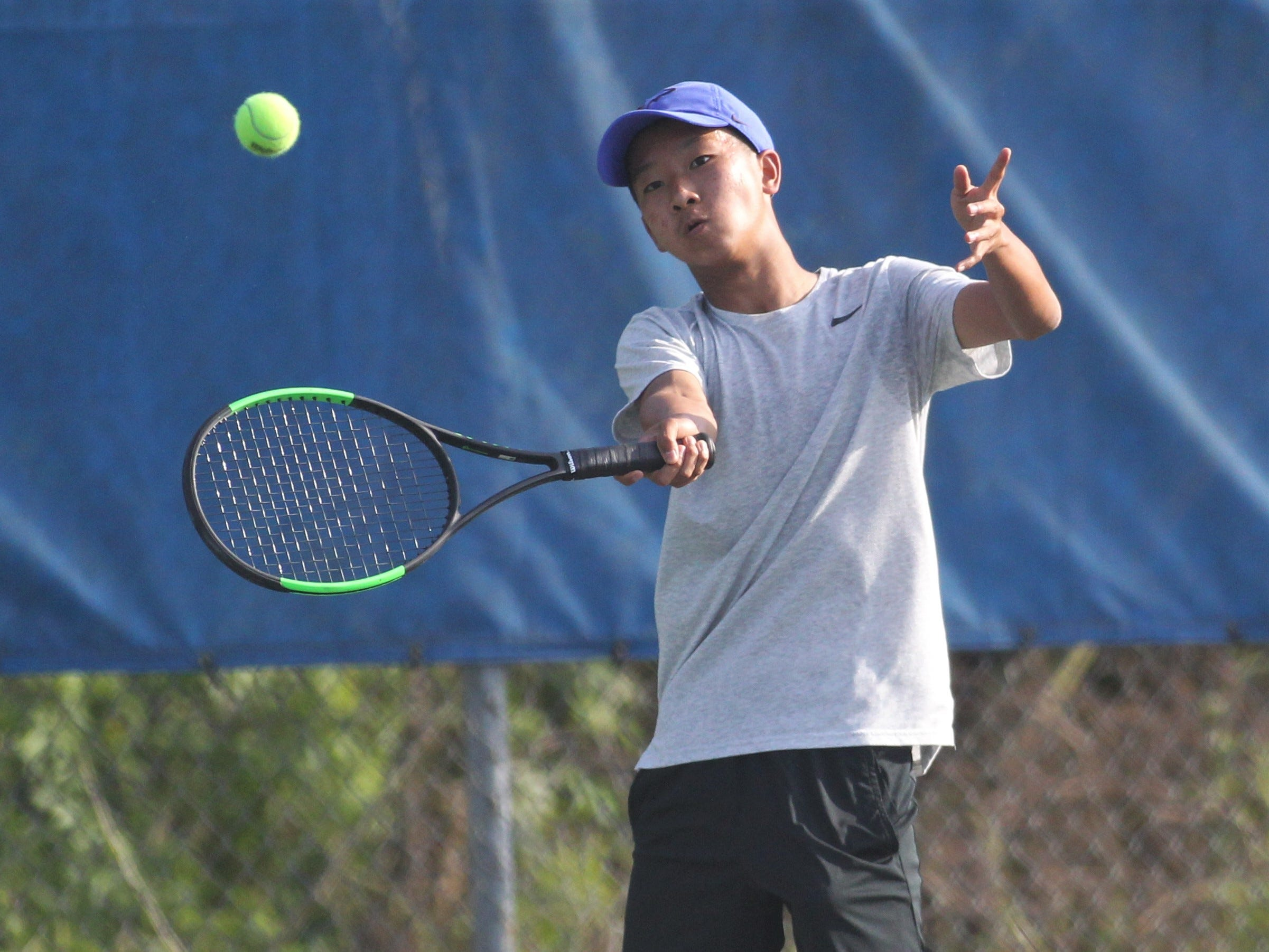 Chiles plays during the boys and girls tennis city tournament at Tom Brown Park on March 13, 2019.