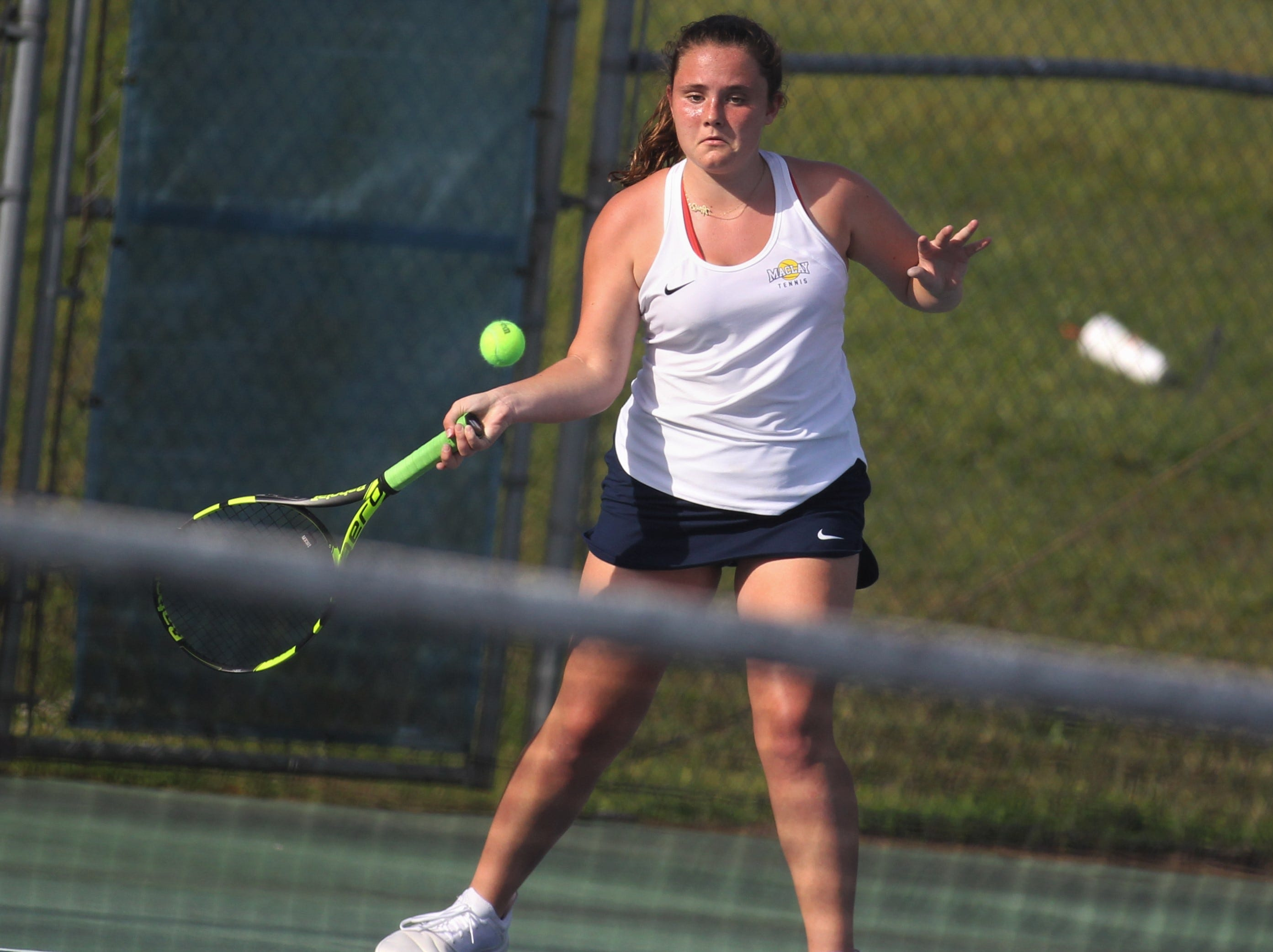 Maclay's Emily Macri plays during the boys and girls tennis city tournament at Tom Brown Park on March 13, 2019.