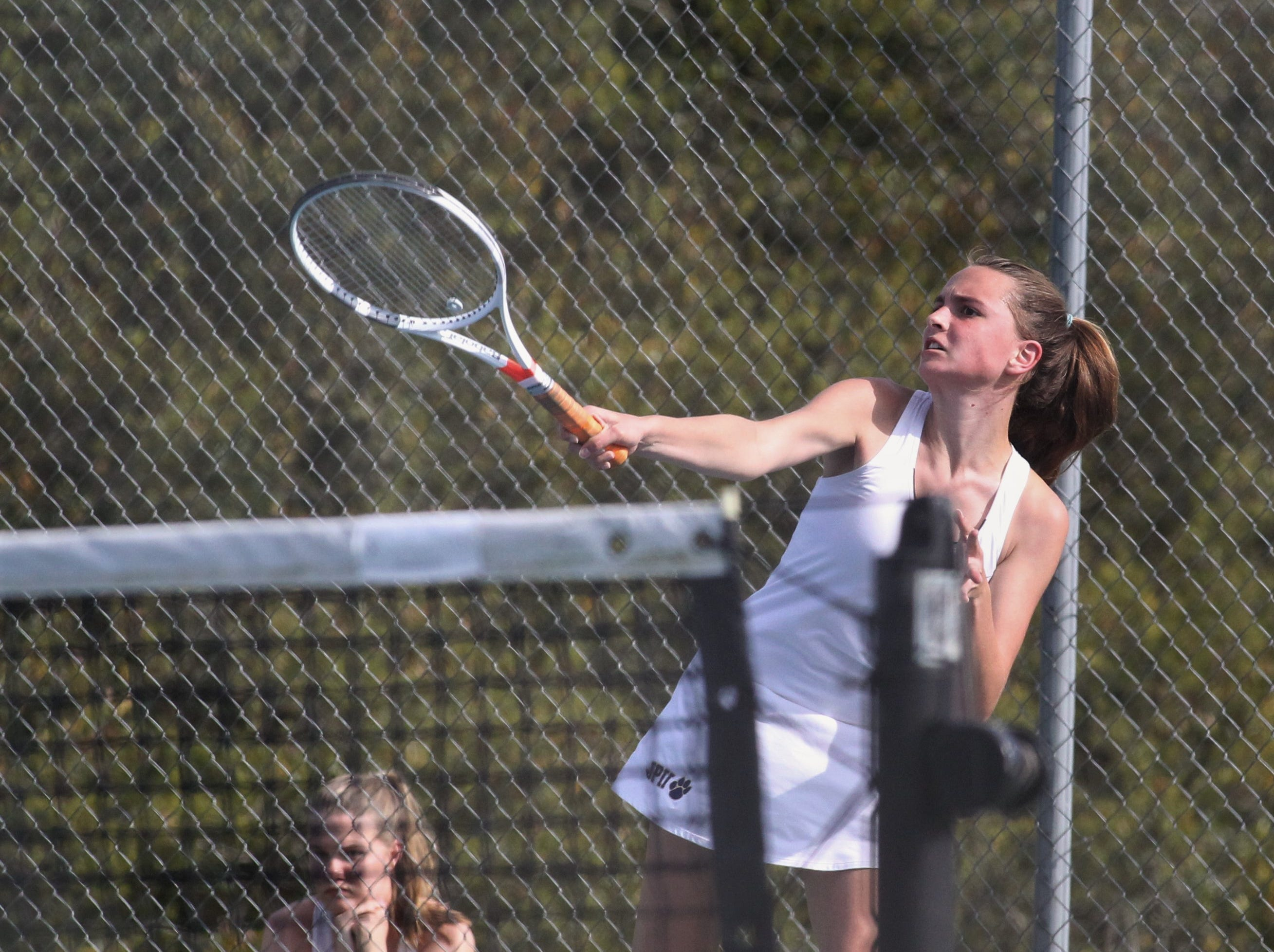 St. John Paul II's Frances Cowles plays during the boys and girls tennis city tournament at Tom Brown Park on March 13, 2019.