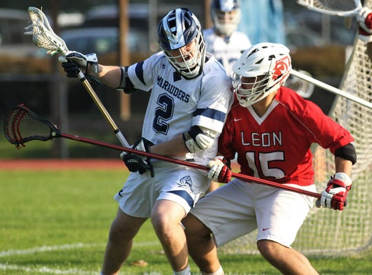 Maclay junior Sam Chase battles against Leon defender Teddy Kirk as the Marauders beat Leon 15-5 on their annual Military Appreciation Night on March 12, 2019.