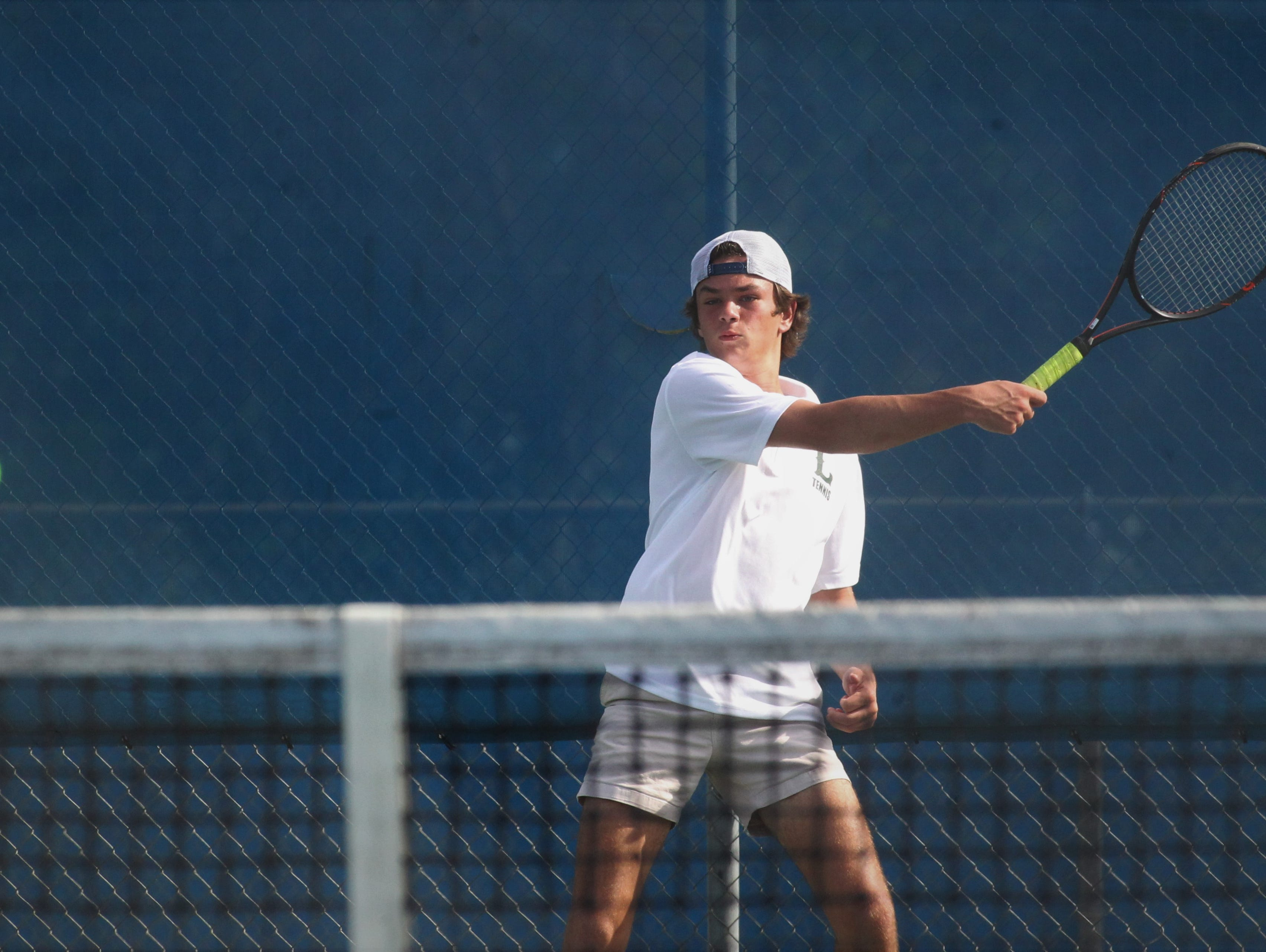 Lincoln's Jay Peacock plays during the boys and girls tennis city tournament at Tom Brown Park on March 13, 2019.