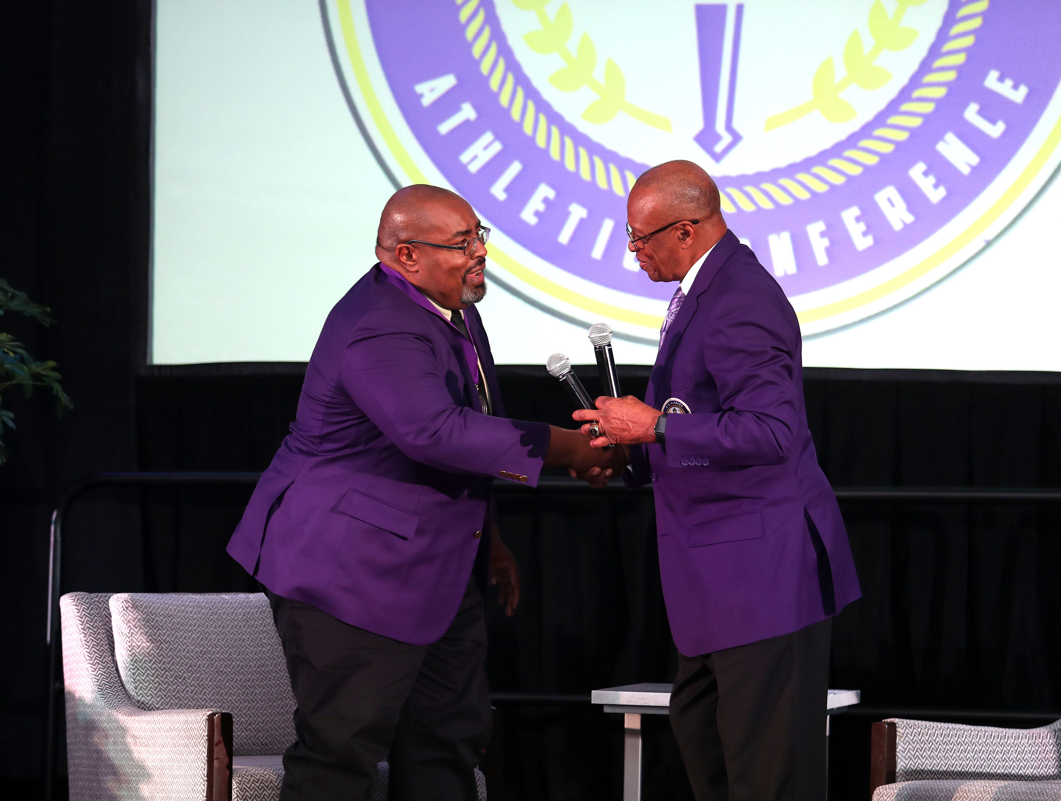 Alvin Hollins is greeted by veteran broadcaster Charlie Neal during the MEAC Hall of Fame ceremony. The event took place on Thursday, March 14, 2019 at the Sheraton Norfolk Waterside Hotel in Norfolk, Virginia.