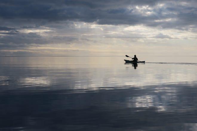Dawn paddler along Piney Island near Panacea.