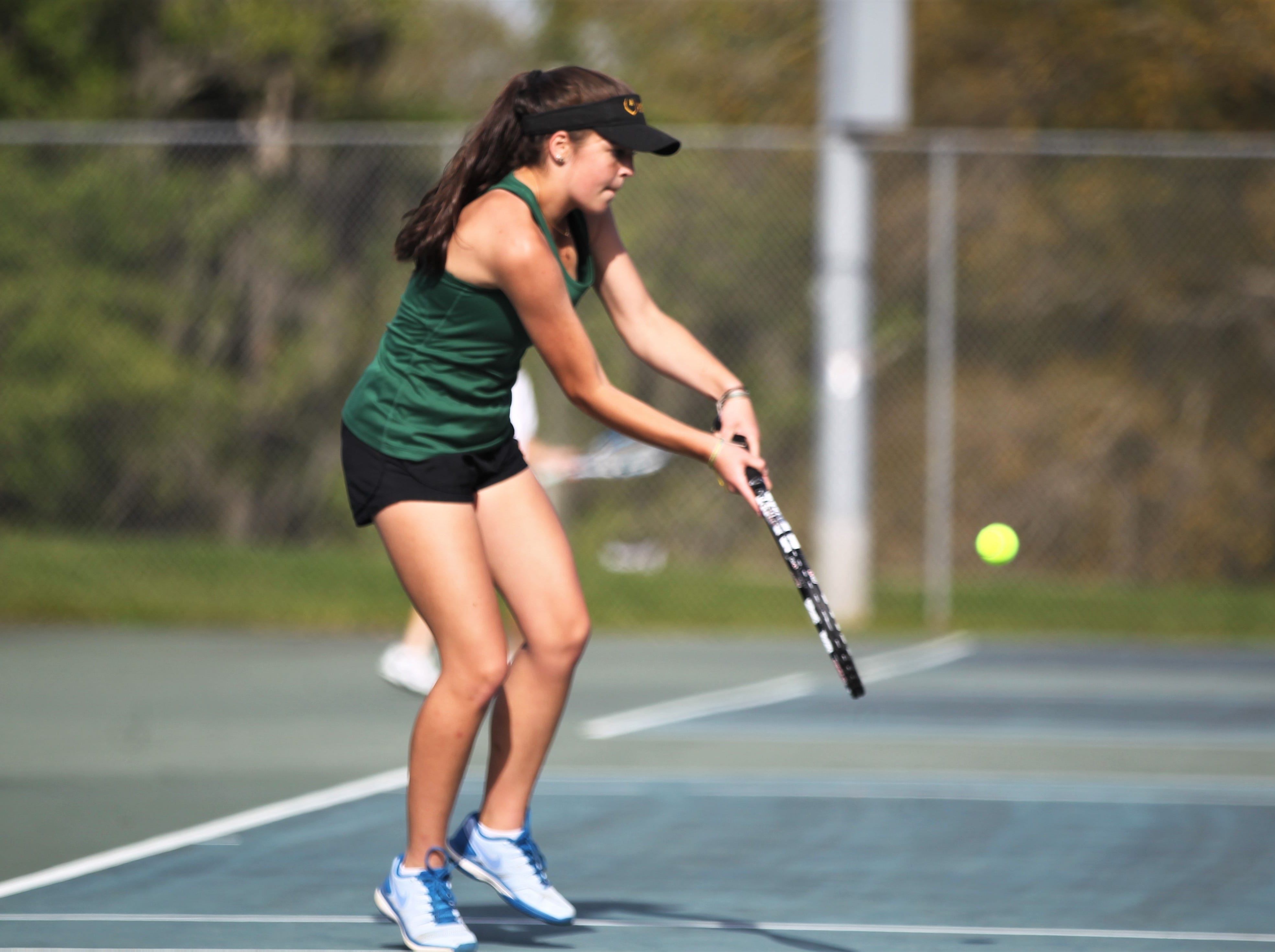 Lincoln senior Kailey Williams plays during the boys and girls tennis city tournament at Tom Brown Park on March 13, 2019.