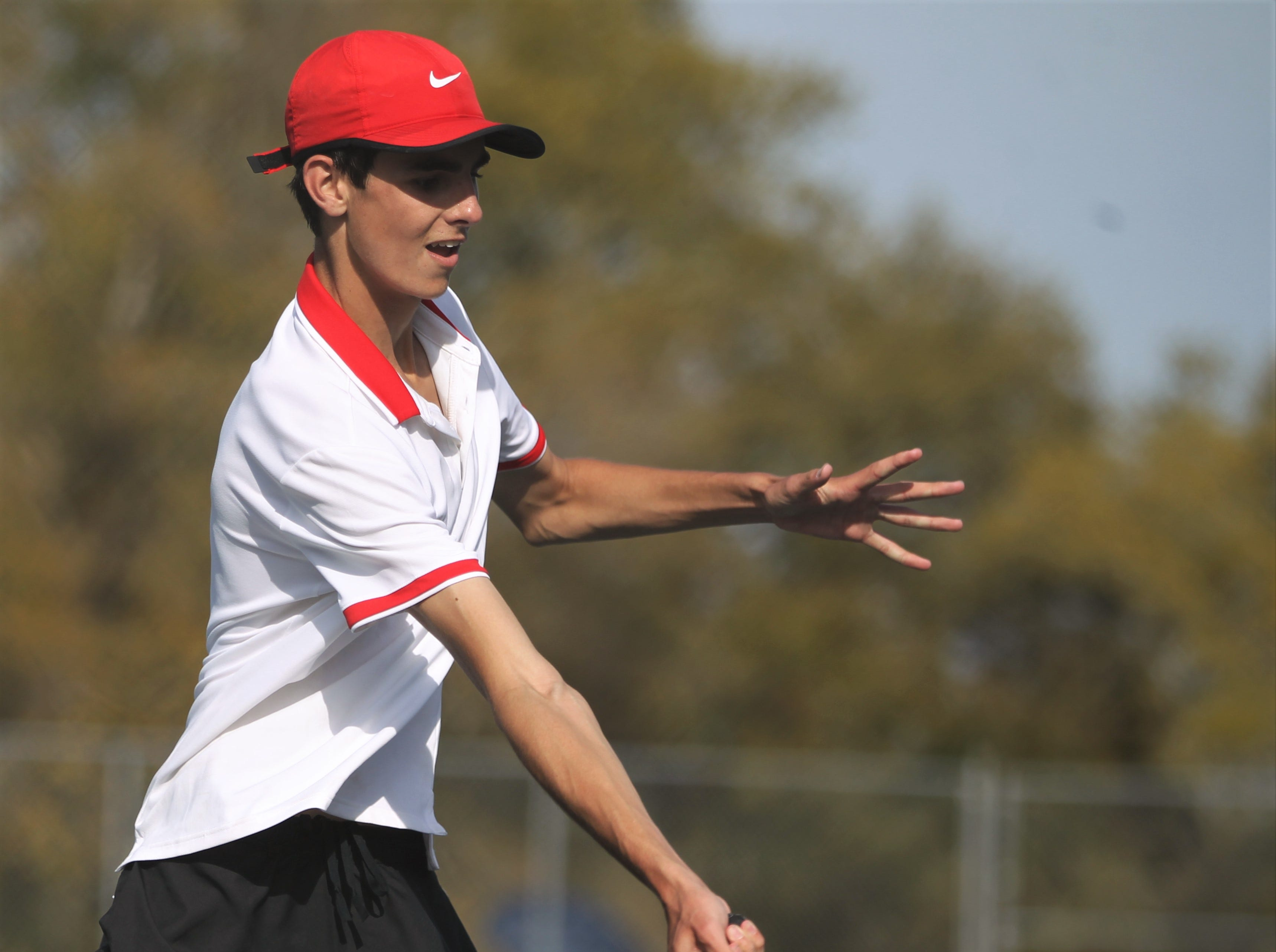 Leon sophomore Parker Kenny plays during the boys and girls tennis city tournament at Tom Brown Park on March 13, 2019.