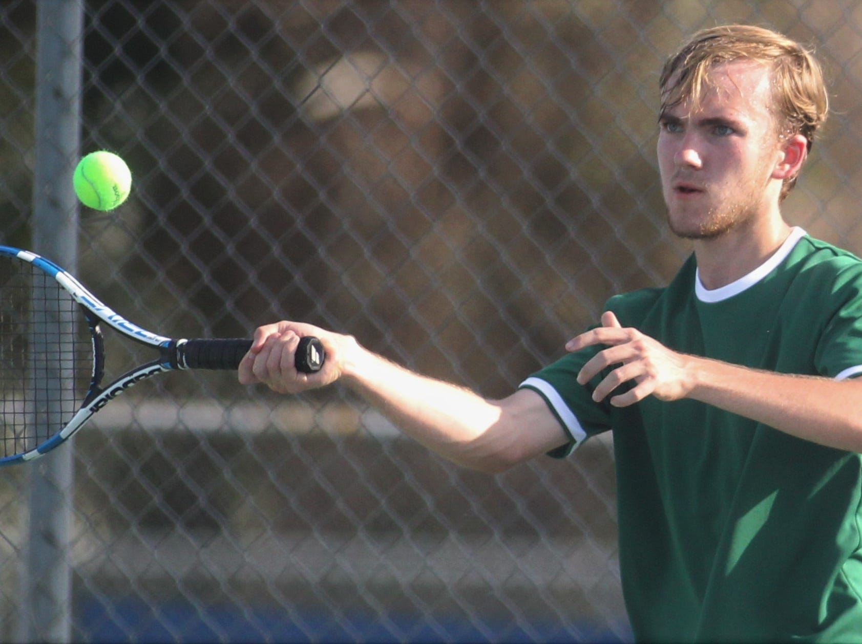 Lincoln's Erik Lamm plays during the boys and girls tennis city tournament at Tom Brown Park on March 13, 2019.
