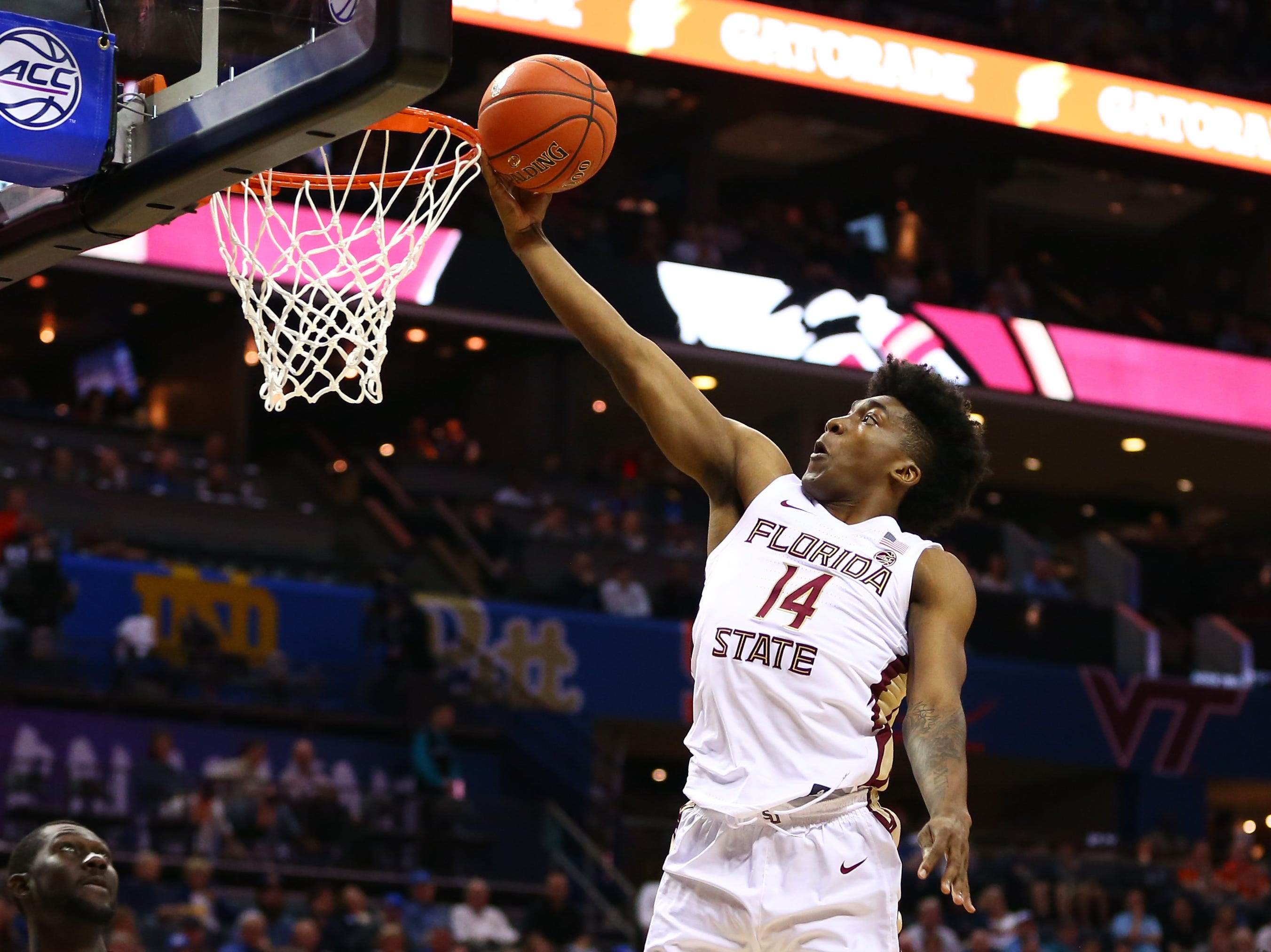 Mar 14, 2019; Charlotte, NC, USA; Florida State Seminoles guard Terance Mann (14) goes up for a shot against the Virginia Tech Hokies in the first half in the ACC conference tournament at Spectrum Center. Mandatory Credit: Jeremy Brevard-USA TODAY Sports